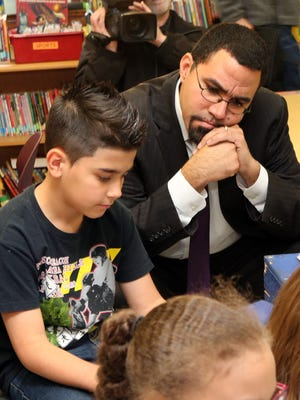 Nick Lopes and state Education Commissioner John King listen as 4th grade teacher Barbara Parmly teaches a U.S. History lesson at the Putnam Valley Elementary School Dec. 1.