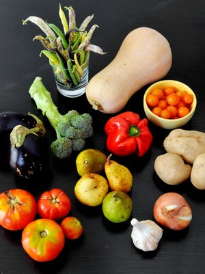 Roughly clockwise, from bottom left: Tomatoes, eggplant, broccoli, beans (green, wax, purple and dragon tongue), butternut squash, bell pepper, sun gold tomatoes, potatoes, onion, garlic and pears. Photo by Chris Dunn.