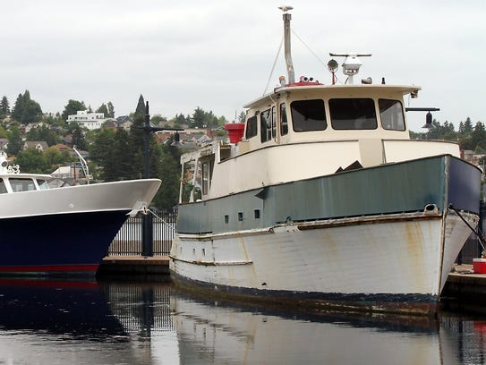 The Eventide, right, at the Bremerton Marina in May