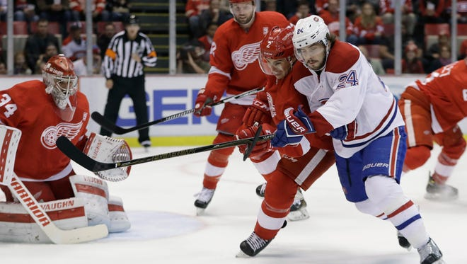 Brendan Smith and Montreal Canadiens left wing Phillip Danault chase the puck Saturday night.