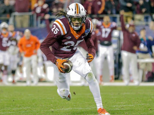 FILE - In this Dec. 29, 2016, file photo, Virginia Tech's Terrell Edmunds (25) runs after an interception against Arkansas during the second half of the Belk Bowl NCAA college football game in Charlotte, N.C. With expectations high for the Hokies' defense this season, brothers Terrell and Tremaine Edmunds figure prominently. (AP Photo/Bob Leverone, File)