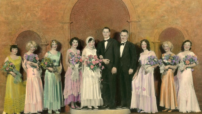 On the podium are bride and groom Aldine Kaser and Wendell Scott flanked by their attendants: maid of honor Dorothy Mills and H.P. Spencer. The girls in the pastel dresses around them are Fanchon and Marco chorus girls, 1930. Photo by the Gunnell and Robb Studio.
