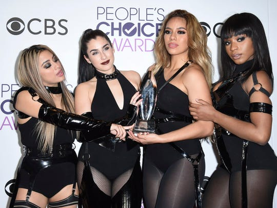 Ally Brooke Hernandez, from left, Lauren Jauregui, Dinah Jane Hansen and Normani Hamilton of Fifth Harmony pose with their award for Favorite Group at the People's Choice Awards.