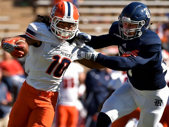 UTEP wide receiver Warren Redix is tackled by Rice