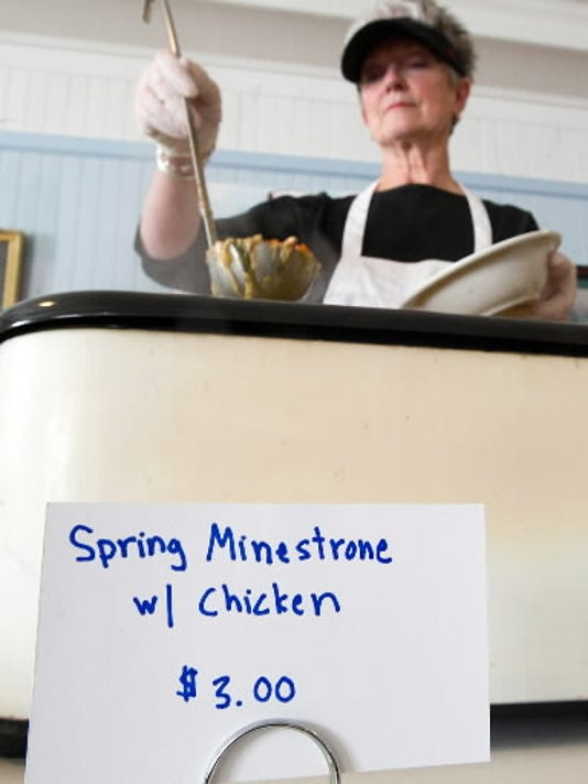 Jane Conover, a volunteer with Healthy World Cafe, spoons out Spring Minestrone with chicken soup at a lunch in April 2012. Healthy World Cafe, which holds monthly lunches, supports a pay what you can model. (Daily Record/Sunday News -- Paul Kuehnel)