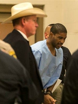 Former Austin Police officer, VonTrey Clark, 32, is escorted into the Bastrop County Jail, in Bastrop, Texas, on Thursday, Sept. 3, 2015, after being extradited from Indonesia. Clark was charged with capital murder and unlawful flight to avoid prosecution in the death of Clark's ex-girlfriend, Samantha Dean. (Rodolfo Gonzalez/Austin American-Statesman via AP)