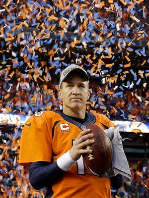 Denver Broncos quarterback Peyton Manning holds his game ball during the trophy presentation following the AFC Championship game between the Denver Broncos and the New England Patriots, Sunday, Jan. 24, 2016, in Denver. The Broncos defeated the Patriots 20-18 to advance to the Super Bowl. (AP Photo/Chris Carlson)