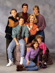 "This 1991 image released by ABC shows the cast of ""Growing Pains,"" standing from left, Leonardo DiCaprio, Alan Thicke and Jeremy Miller, with Kirk Cameron, seated center left, and Joanna Kerns, seated center right, and Tracey Gold, seated left on floor and Ashley Johnson. Thicke, who played Dr. Jason Seaver, a psychiatrist and ideal TV dad, died on Tuesday, Dec. 13, 2016. He was 69."