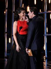 Idina Menzel and John Travolta present nominees for best song at the 87th annual Academy Awards.