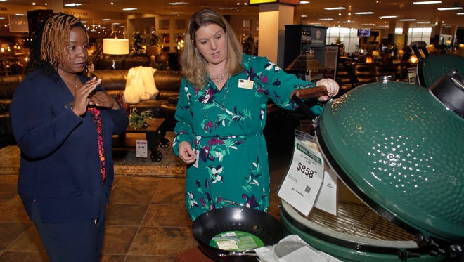 Steinhafels manager Summer Barnes, right, and sales associate Sherice Burkett discuss products available for spring 2017 at the Steinhafels store in Oak Creek. The furniture retailer says its diverse workforce broadens its perspective and helps it continue to grow.