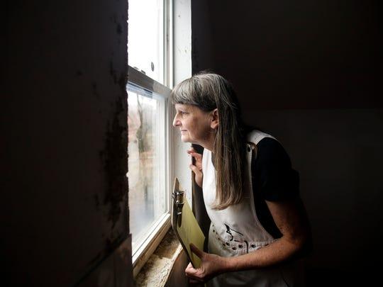 Veterinarian Nancy Bischof looks down on an empty yard