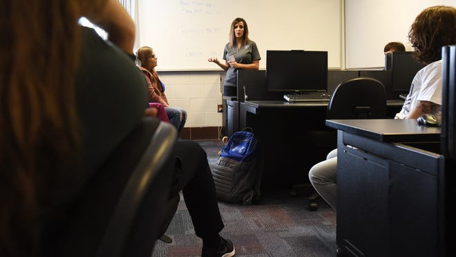 Jennifer King, student success coach and political science instructor at Zane State College, talks to a group of seniors during the 12th Grade Redesignprogram recently.
