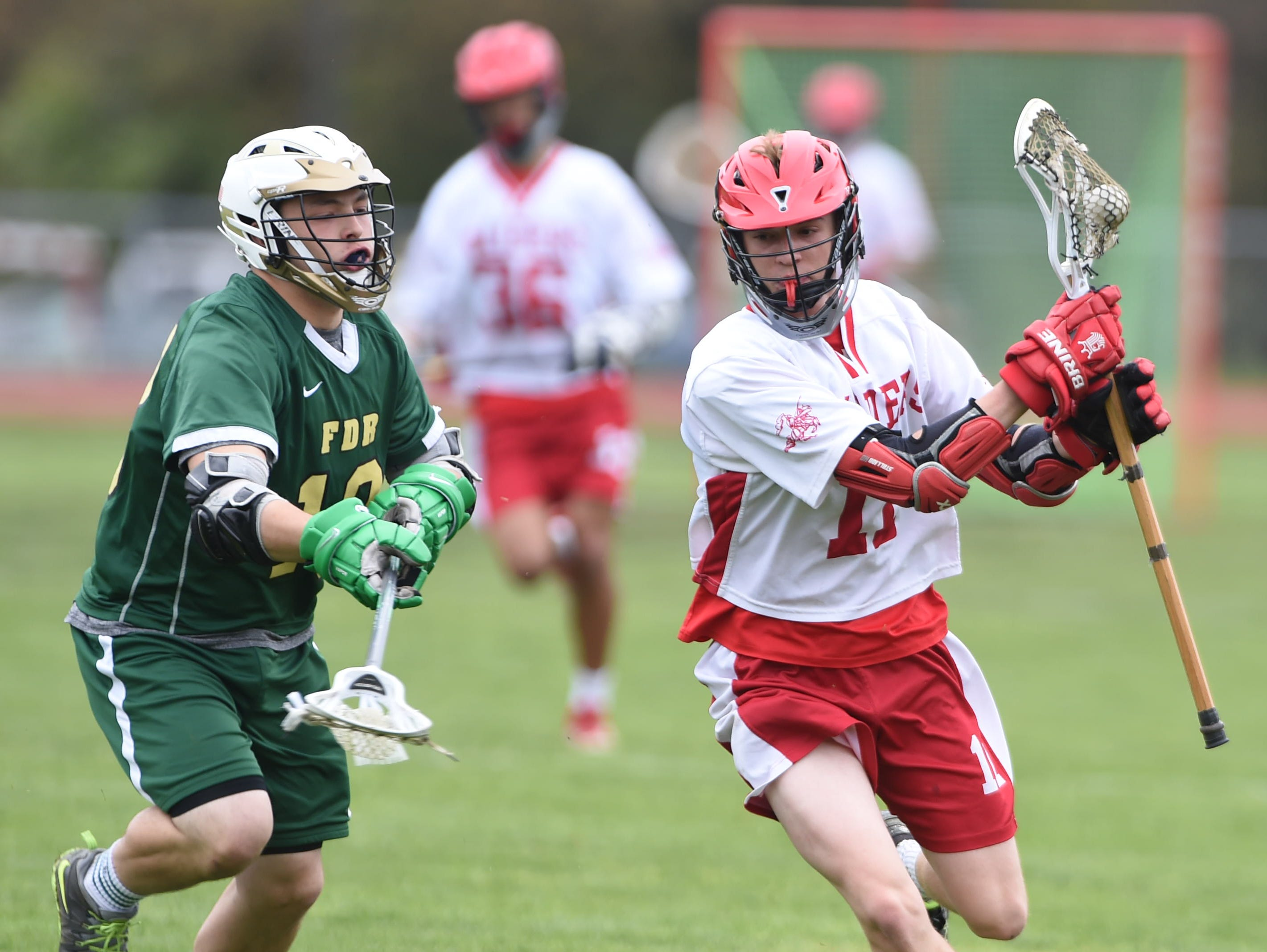 Red Hook's Mikey Gildersleeve is covered by FDR's Geno Coppola during Tuesday's game at Red Hook.