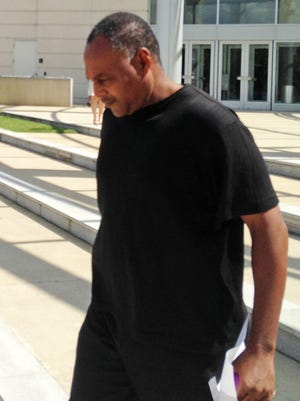 Bryan Jones, a former Jackson, Miss., police officer, leaves the federal courthouse, Thursday, Sept. 24, 2015, in Jackson, Miss.