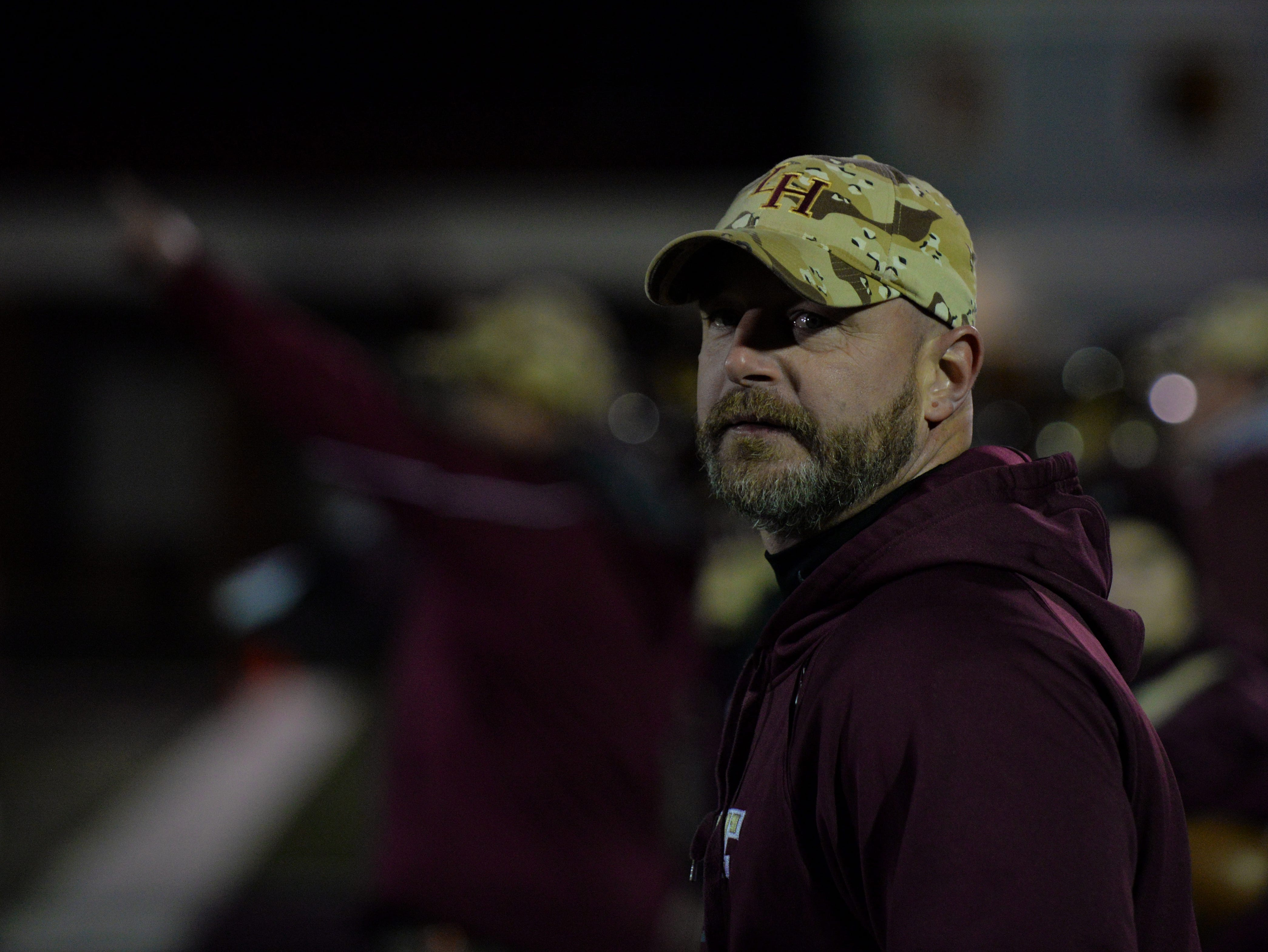 Licking Heights coach Darren Waters watches the clock during a Division II regional semifinal loss to Worthington Kilbourne. He led the Hornets to their third 10-win season since 2007.
