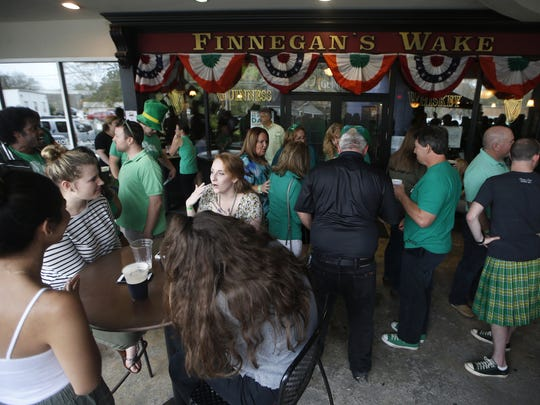 Patrons celebrate St. Patrick's Day at Finnegan's Wake