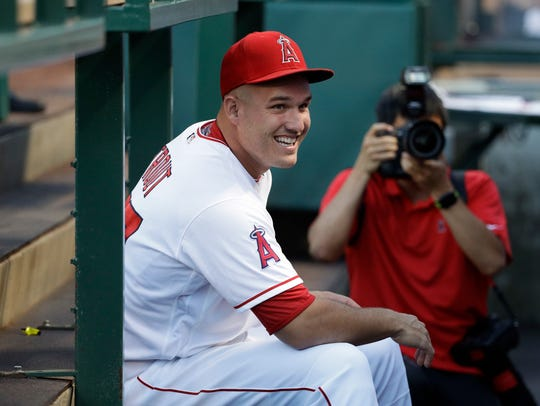 Los Angeles Angels' Mike Trout smiles while chatting