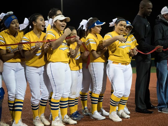 Moody's softball team helps cur the ribbon for the