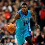 Charlotte Hornets forward Michael Kidd-Gilchrist (14) dribbles with the ball against the Chicago Bulls during the first half of their NBA game at United Center.