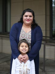 Petra Gonzalez and her daughter Zaira, 6, pose for