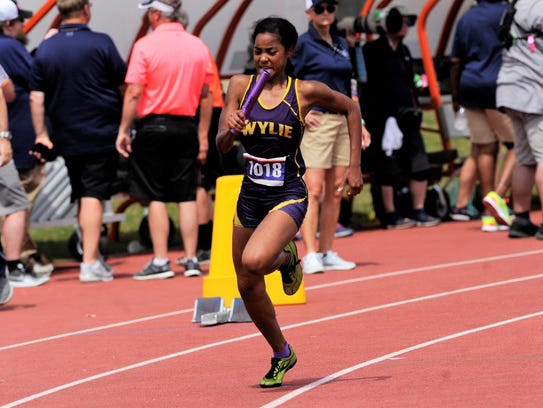 Wylie's Brianna Douglas starts the Class 4A girls mile relay at the UIL State Track and Field Championships. Her unit took the bronze medal.