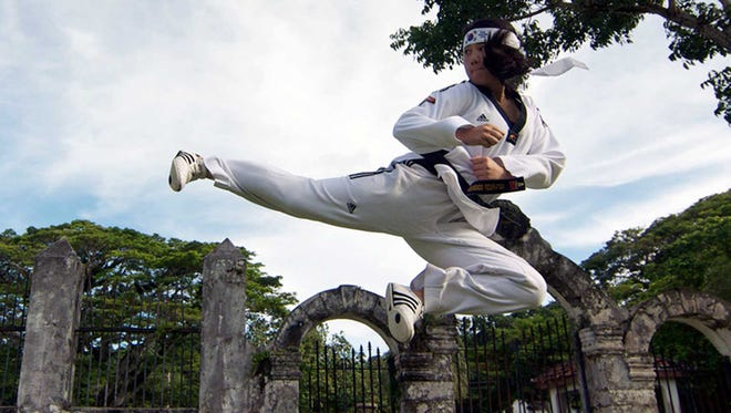 Third-degree taekwondo black belt Michelle Caluag is seen executing the flying side kick during an exhibition at the Plaza de Espana.Guam Taekwondo Center is organizing the Third Annual Flying Side Kick Tournament June 27 at the center court of the Micronesia Mall. The public is invited to watch from 10 a.m. to 5 p.m. For more information about the tournament or on future events, call chief instructor Noly Caluag at 637-7000, find guamtaekwondo on facebook or email master_noly@guamtaekwondo.com.