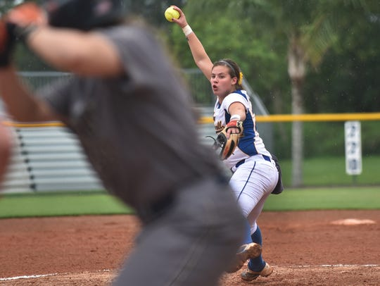 John Carroll pitcher Ashley Montoya (right) fires to