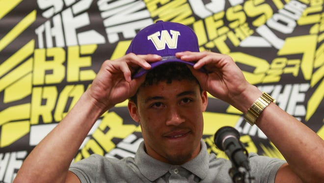 Byron Murphy, wide receiver and cornerback at Saguaro High School, makes his official college decision with the University of Washington on Thursday, Jan. 21, 2016, at Saguaro High School in Scottsdale, Ariz.