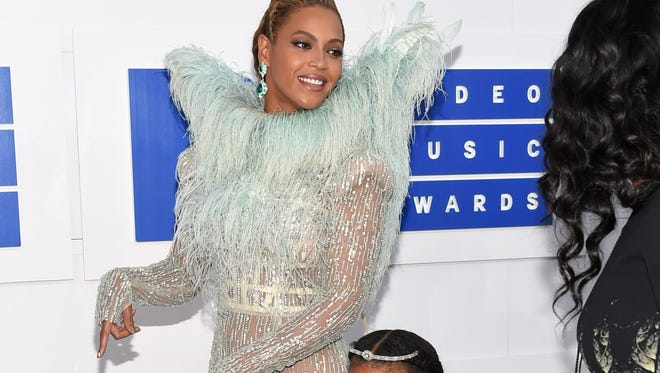 Beyoncé, left, and her daughter, Blue Ivy, arrive at the MTV Video Music Awards on Sunday in New York.