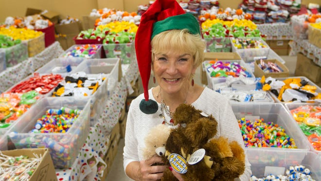 Lee Knapp, the founder of Stockings 4 Kids, and her volunteers have set up a warehouse with an array of toys to be packed into stockings for children in need. Ninety elves ages 3-18 are scheduled to assemble 3000 stockings on December 5. The warehouse space is provided by United Mechanical.