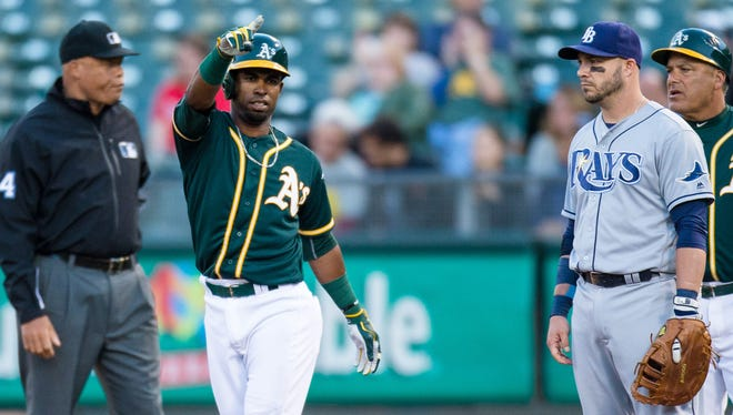 Oakland Athletics shortstop Arismendy Alcantara (30) reacts after he hit a single against the Tampa Bay Rays  in the third inning at O.co Coliseum on July 22.