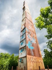 Bren Alverez's 38-drawer tall filing cabinet sculpture on Flynn Avenue was built in 2002, directly in the path of the proposed Champlain Parkway project.