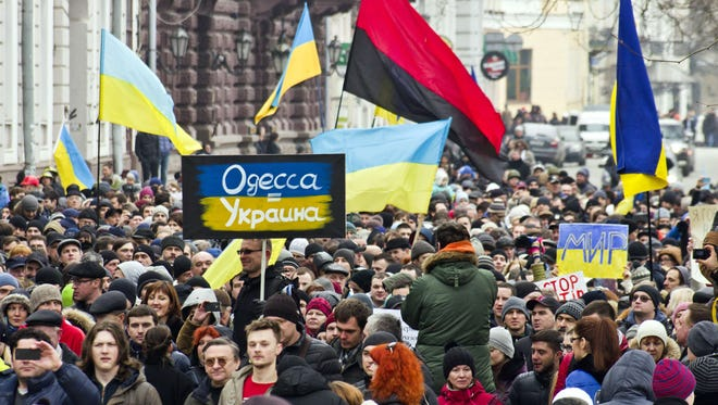 People attend an anti-war rally and march in the south Ukrainian city of Odessa on March 2.