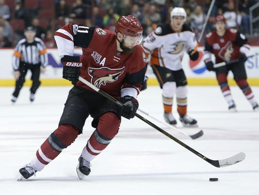 FILE - In this Feb. 20, 2017, file photo, Arizona Coyotes center Martin Hanzal (11) moves with the puck during the team's NHL hockey game against the Anaheim Ducks in Glendale, Ariz. The NHL trade deadline is looming over the league, leading to players such as Detroit Red Wings defenseman Brendan Smith and forward Thomas Vanek wondering if they will be dealt. Both players have expiring contracts, making them attractive on the market, along with Arizona's Hanzal, Dallas' Patrick Eaves and Tampa Bay's Ben Bishop. (AP Photo/Rick Scuteri, File)