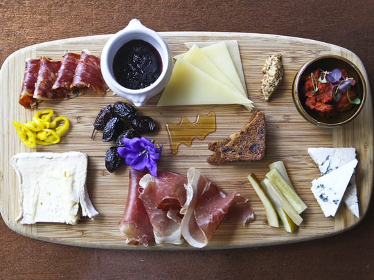 The weekly charcuterie board with accompaniments at Wiltshire on Market features a variety of cheeses, meats as well as honey or a compote for adding a finishing flavor.