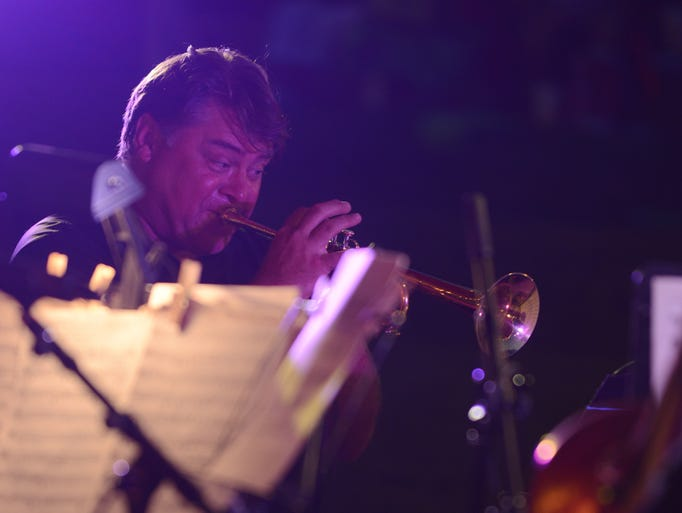"""Scoot Moore, a member of the Jackson """"Five"""" Brass Works, plays the trumpet in front of a crowd at the Jackson amphitheater Friday evening."""