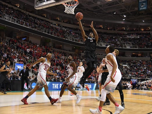 Xavier's Quentin Goodin shoots against Arizona during