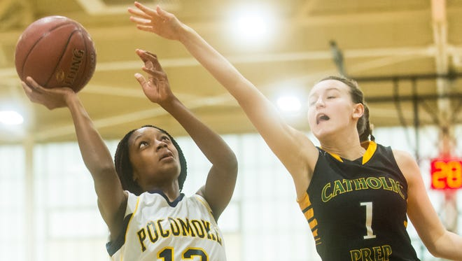 Pocomoke guard Shayla Jones (12) takes a shot against Saint John's Catholic Prep on Wednesday, December 30th in the WallerDome at Wicomico High during the Governor's Challenge.
