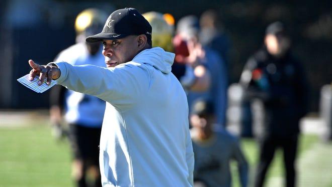 Coach Derek Mason directs his players during Vanderbilt's first practice of spring football Monday.