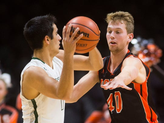 Powell's Westin Reynolds (40) defends a Webb player during the 2017 Knox County Schools Tennova Tip-Off classic in Thompson-Boling Arena Wednesday, Nov. 8, 2017.