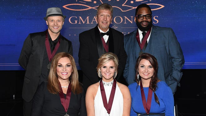Back row, from left, Jason Clark, Howard Rachinski and Hezekiah Walker; front row, from left, Kelly Nelon Clark, Autumn Nelon Clark and Amber Nelon Thompson attend the third annual GMA Honors on May 10, 2016, in Nashville, Tennessee.