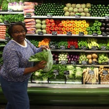 Patty Whitaker of Madison Heights shops for produce with her grand daughter Mia Whitaker at Whole Foods in Detroit in June 2013.