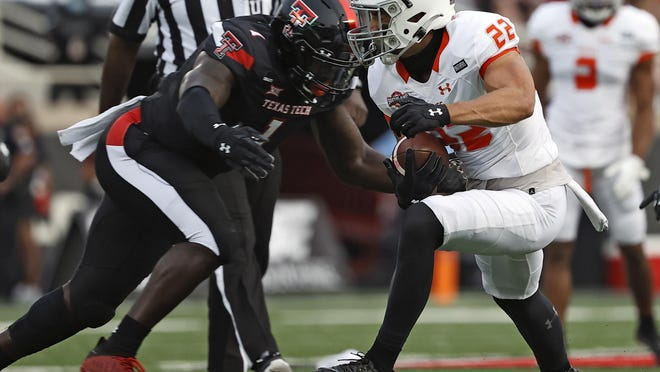 Texas Tech linebacker Krishon Merriweather (1) zeroes in on Houston Baptist wide receiver Ben Ratzlaff (22) during the Red Raiders' 35-33 victory Saturday at Jones AT&T Stadium. Merriweather finished with 12 tackles and on Monday was named the Big 12 defensive player of the week.