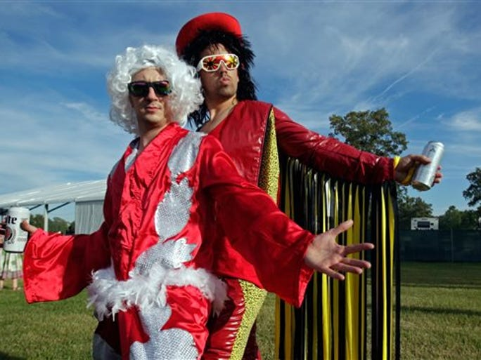 Bonnaroo participants who wouldn't give their real names are dressed as 'Nature Boy' Rick Flair, left, and Randy 'Macho Man' Savage are seen at the Bonnaroo Music and Arts Festival on Thursday, June 9, 2016, in Manchester Tenn.