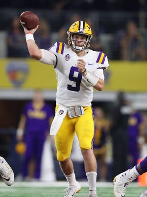 Sep 2, 2018; Arlington, TX, USA; LSU Tigers quarterback Joe Burrow (9) throws in the pocket against the Miami Hurricanes at AT&T Stadium. Mandatory Credit: Matthew Emmons-USA TODAY Sports