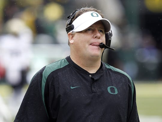 FILE - In this Oct. 27, 2012, file photo, Chip Kelly, at the time Oregon's coach, watches the clock wind down during the final moments of the team's NCAA college football game against Colorado in Eugene, Ore. Associated Press college football writers predicts that, after this season, UCLA will part ways with Jim Mora and hire Kelly. (AP Photo/Don Ryan, File)