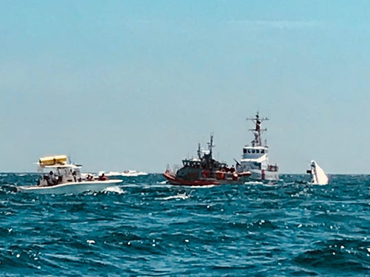 Eleven people were rescued near Pensacola Beach on Saturday afternoon after their boat capsized.
