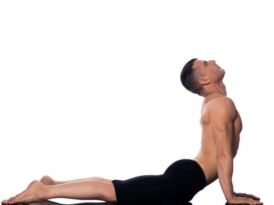 Men are invited to work on their cobra pose in a beginner's yoga class at The Yoga Studio at City Center.