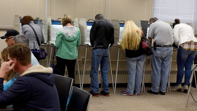 Voters cast their absentee ballots in the Minnehaha County Administration Building in downtown Sioux Falls on Friday, Oct. 28, 2016.