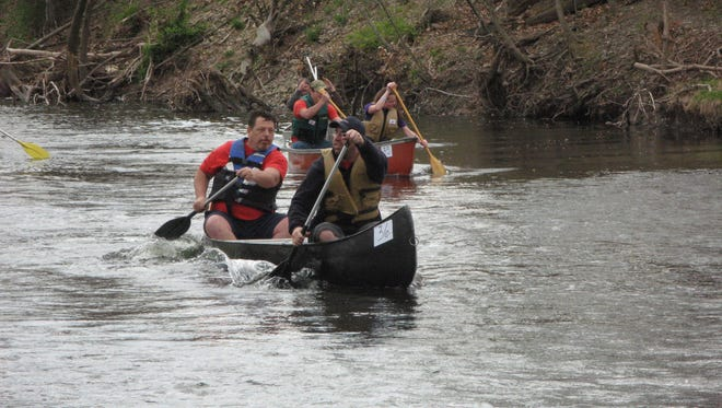 A group of paddlers make their way down the Wappinger Creek in Pleasant Valley during the Wappingers Creek Water Derby on Saturday.